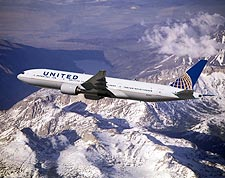 United Airlines Boeing 777-200 Over Mountains Photo Print for Sale