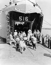 Vietnamese Refugees Board U.S. Navy Ship LST 516 Photo Print for Sale