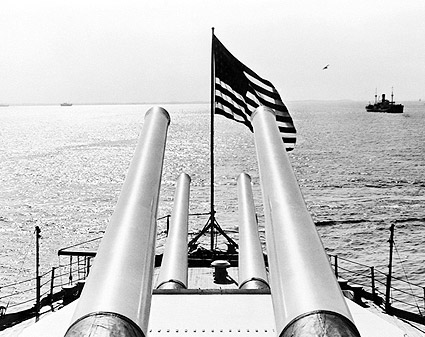 WWII Battleship Guns and Flag Scan the Sea Photo Print
