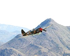 WWII P-40 Warhawk Aircraft Banking Photo Print for Sale