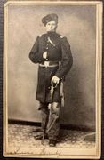 Cdv of 3rd Minnesota Infantry officer Lewis Hardy wearing fur hat and armed with a sword