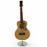 A Miniature Replica of a Classical Stringed Spanish Acoustic Guitar With Stand & Case