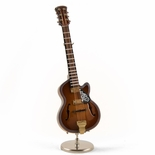 An Incredible Miniature Replica of Dark Wood Tone F-Hole Archtop Guitar with Stand & Case