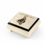 Stunning 18 Note Ivory Stain Beatrix Potter Music Box with Tales of Peter Rabbit Wood Inlay
