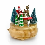 Santa Clause with Reindeers Flying Through the Snow Musical Figurine