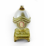 Victorian Emblem Musical Goose Egg with Gold Fabric base with Miniature 18 Note Movement