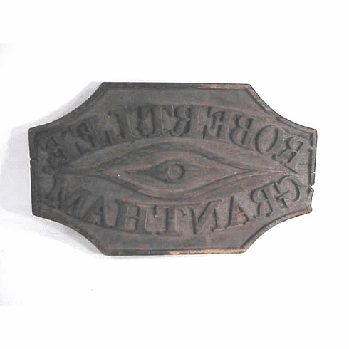 A carved and painted wooden marker