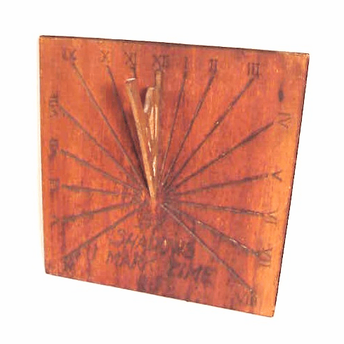 A carved wooden sundial dated 1919