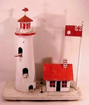 A lighthouse birdhouse in old paint.