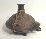 A pottery bottle in the form of a turtle