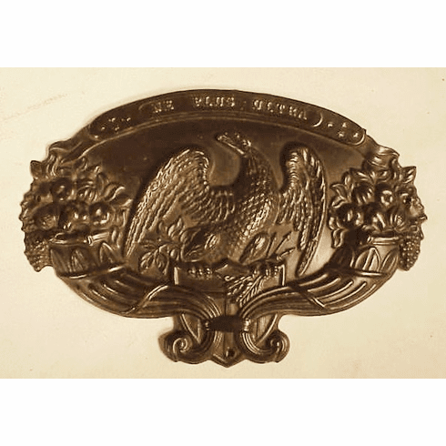 Antique American brass crest with American Eagle