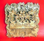 Antique carved wooden wall pocket