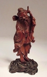 Antique Oriental carved figure on stand
