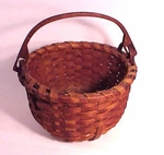 Antique swing-handled basket with wooden bottom