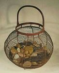 Antique wire and iron basket in original paint.