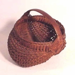 Antique woven splint buttocks basket.