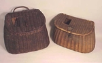 Two antique fishing creels.