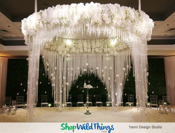 The Key to a Black, White and Romantic All Over Hotel Reception?  Crystals, Chandeliers and Candles