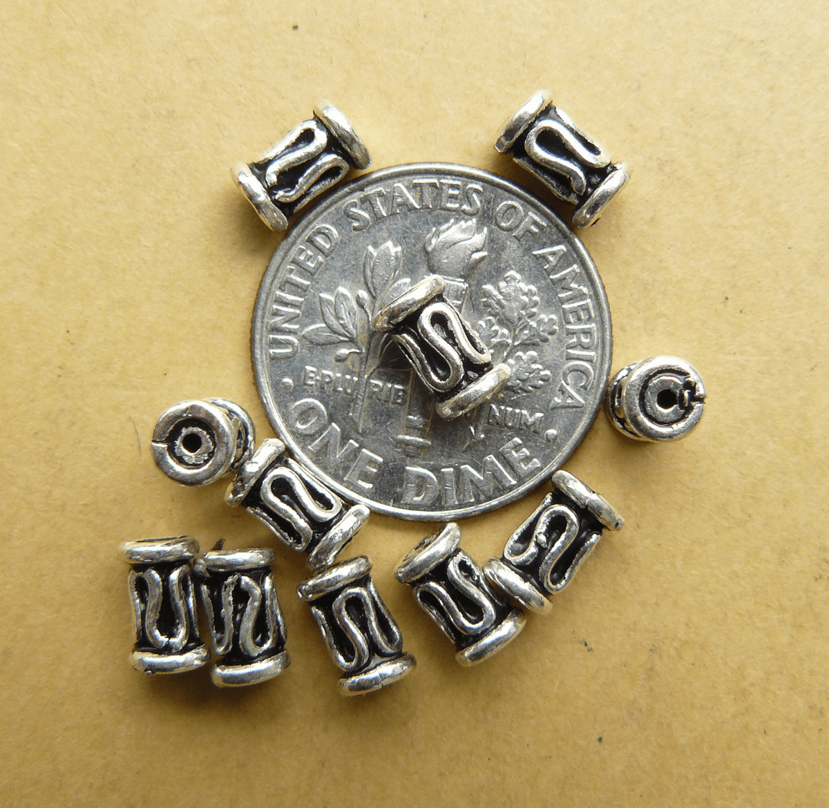 11 Sterling Silver Tube 4x6mm Bead with scroll design