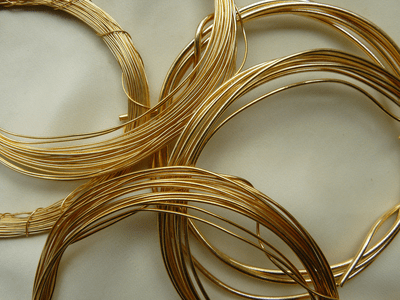Wire 24 kt. Gold Over Copper Core for wire wrapping. Pound it bend it doesn't chip or peal
