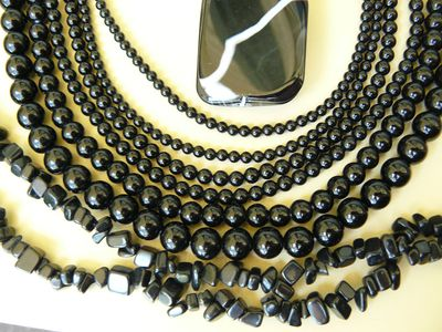 Black Onyx beads with many different cuts and shapes