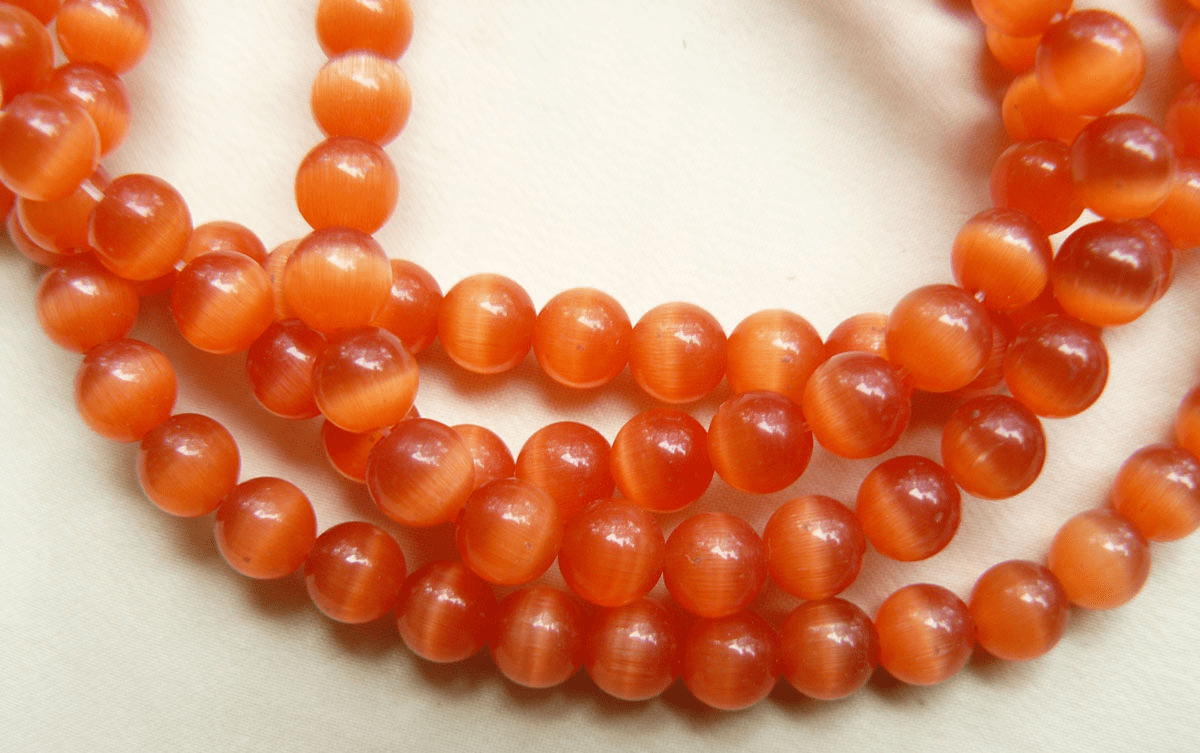"Cats Eye Orange Beads 4 round 16"" strands"