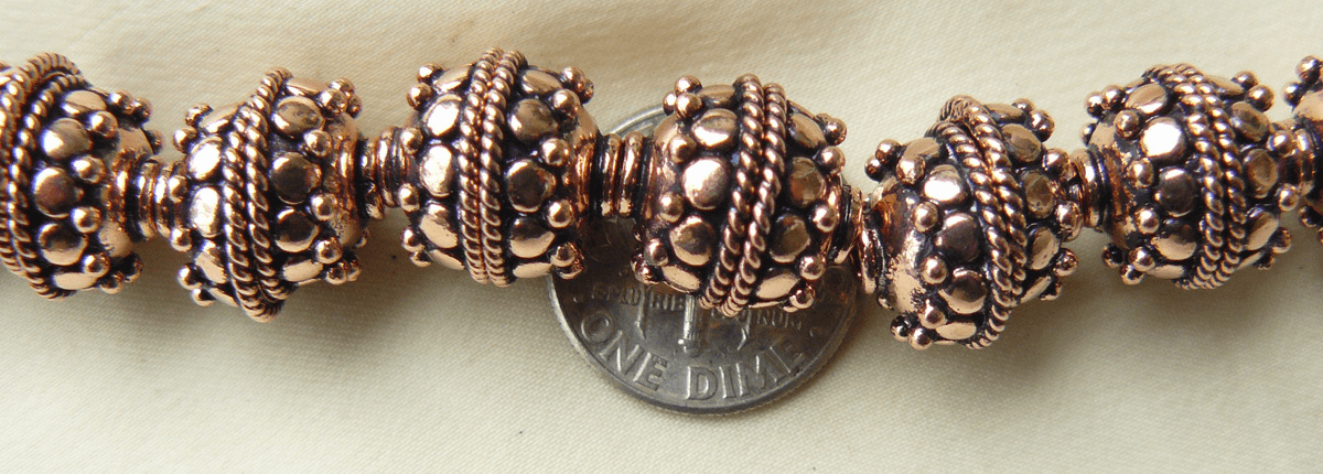 Copper 12mm bead caps with Bali style design 34 pieces