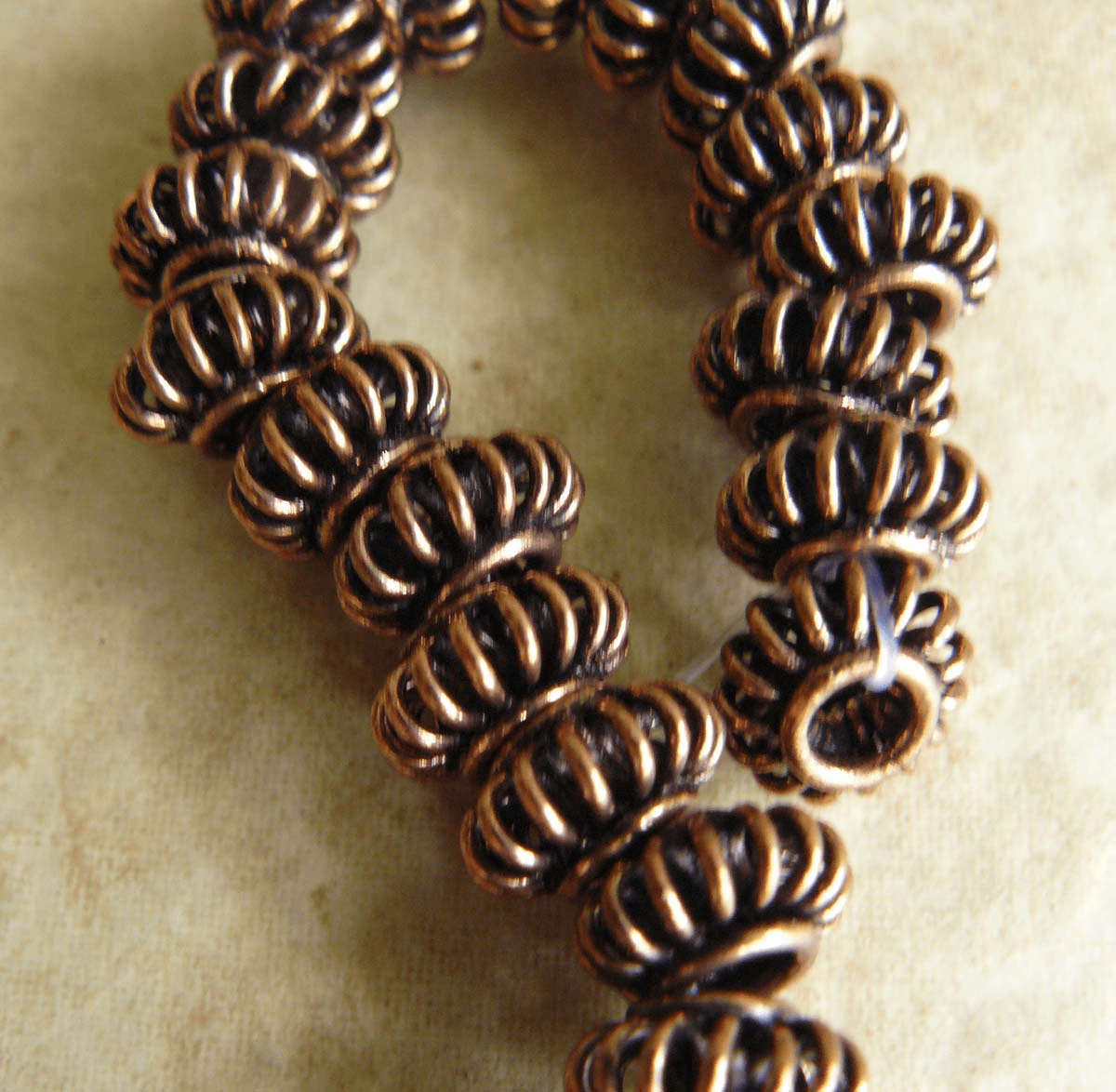 Copper basket beads 5x10mm 33 beads medium antique finish
