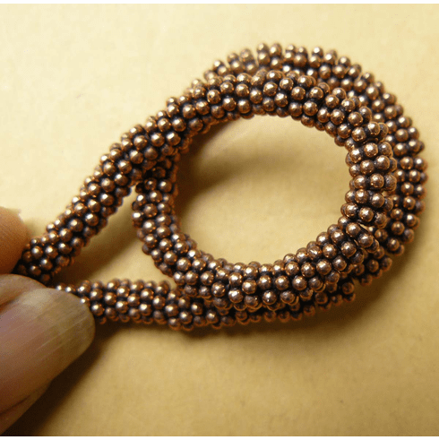 Copper Daisy spacer 8mm over 75 beads