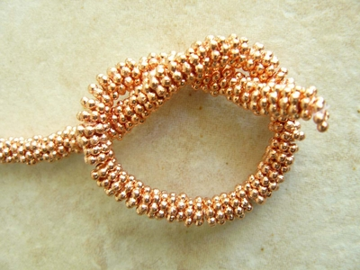 "Copper daisy spacers 6mm Bright finish 8"" strands"