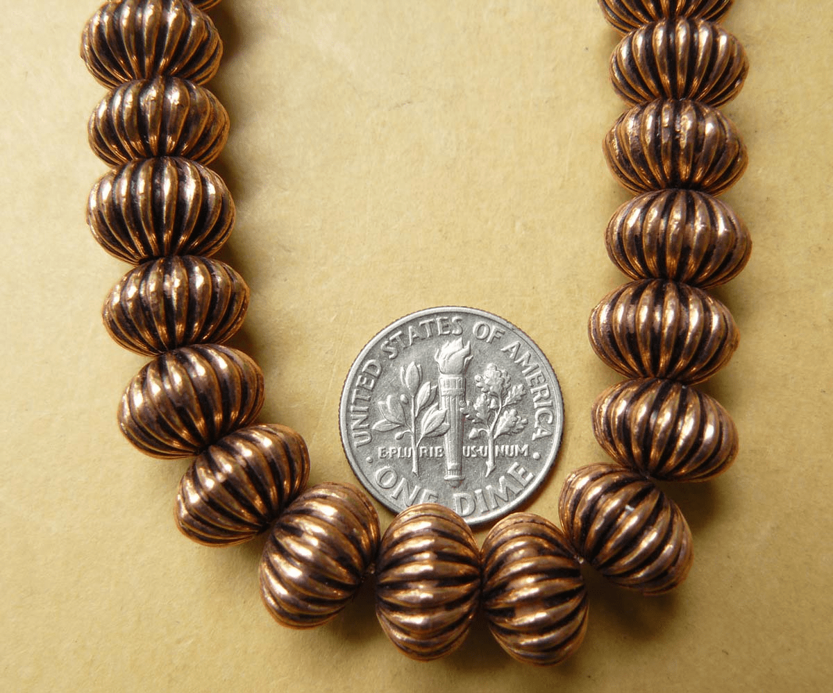 Copper grooved puffy oval bead over 27 beads 8x10mm