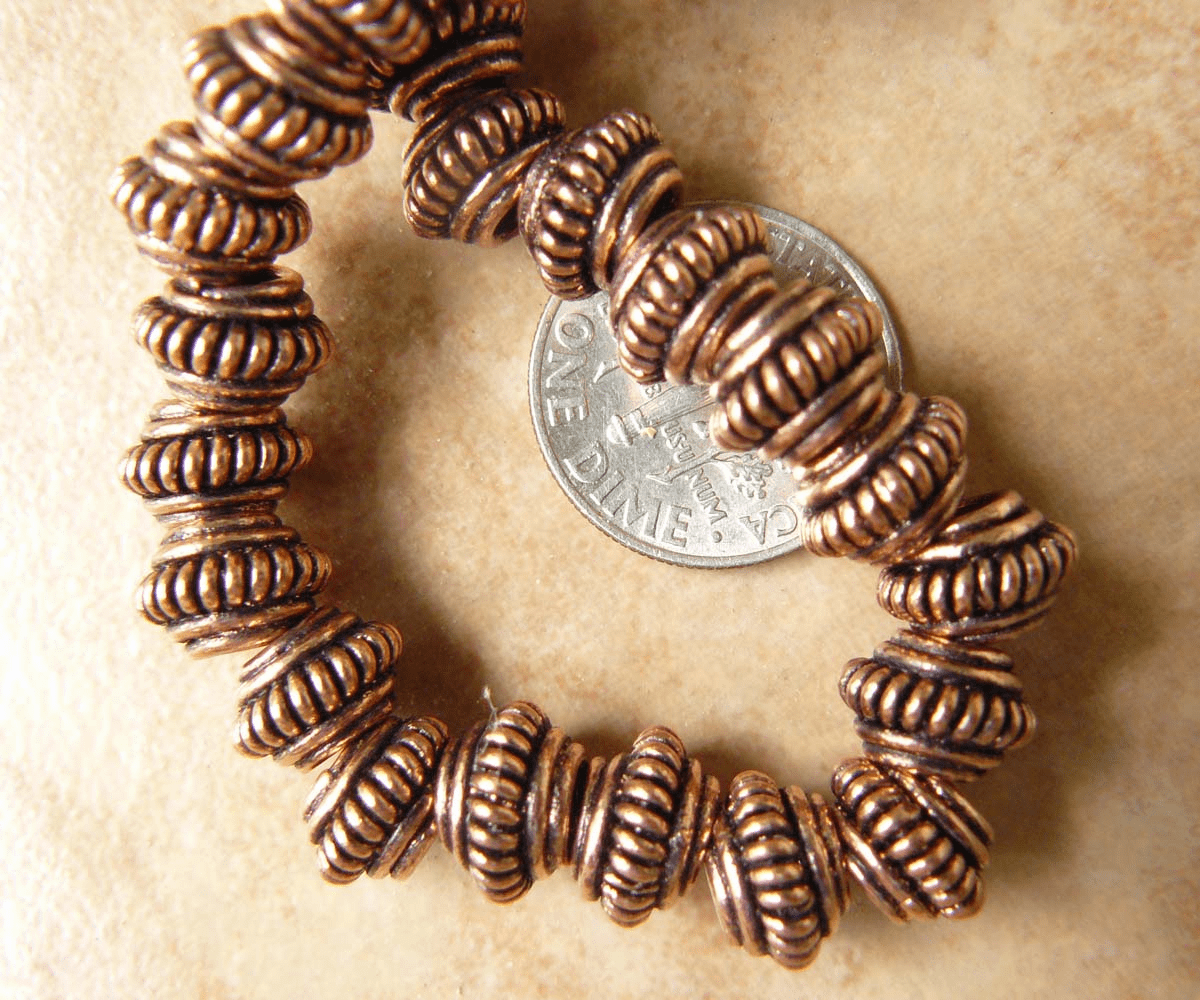 Copper larger hole beads 6x9mm with 3mm hole 11 beads