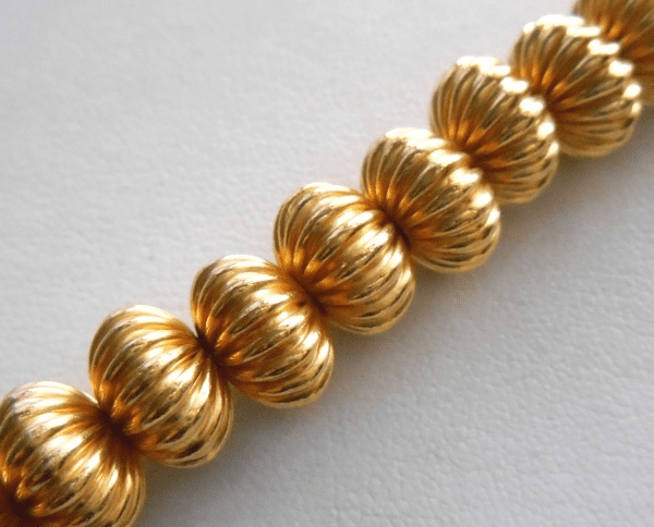 Corrugated Bead - 7x11mm - 28 Beads - 24kt Gold Over Copper<br>GCBK111B