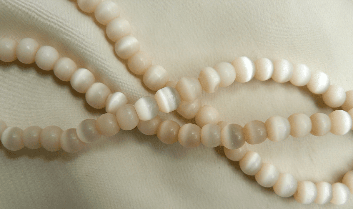 """Creamy colored Cats eye beads 4-6 and 8mm 16"""" strands"""