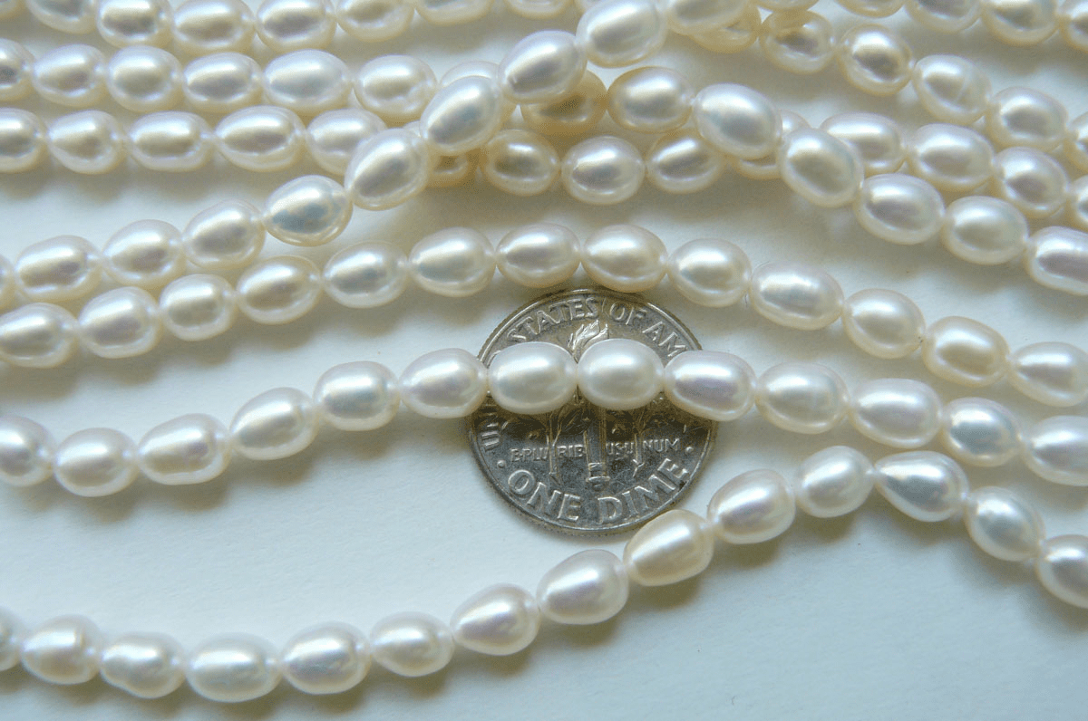 """Ivory White Fresh Water Pearl 5x7mm rice A grade 15"""" strands"""