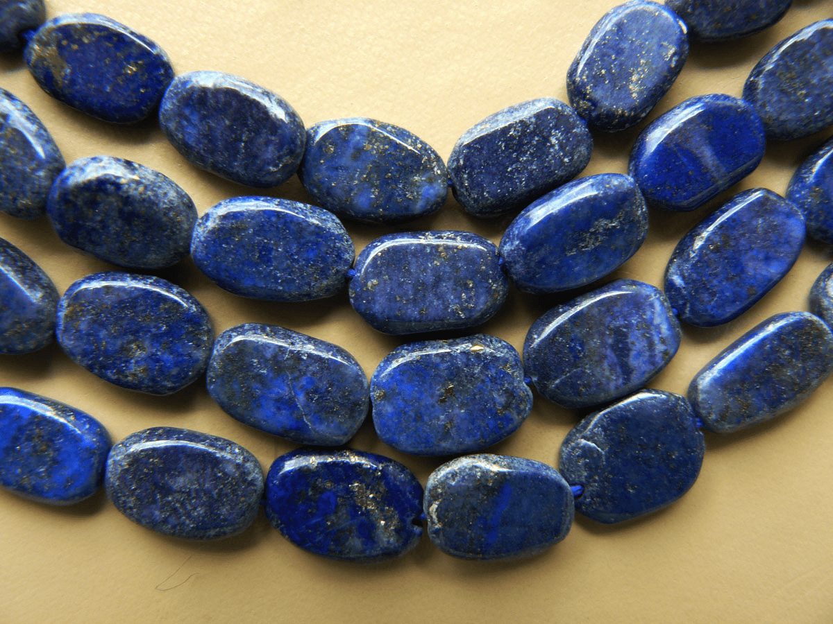 "Lapis flat Ovals 8x12mm 15"" strands"