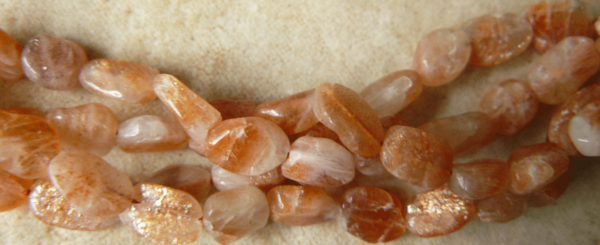 """Sunstone Smooth Oval Beads 5x7mm 16"""" strands"""