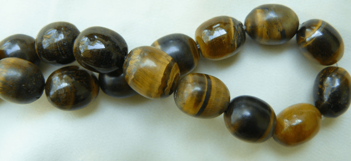 "Tiger Eye Oval Beads 11x13mm barrel style 16"" strands"
