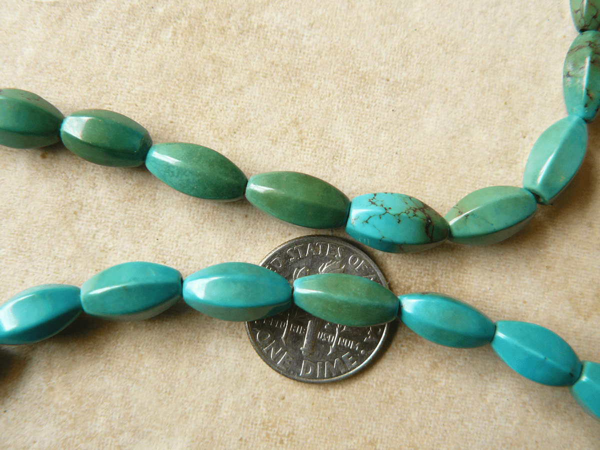 "Turquoise Tube beads with faceted sides 16"" strands"
