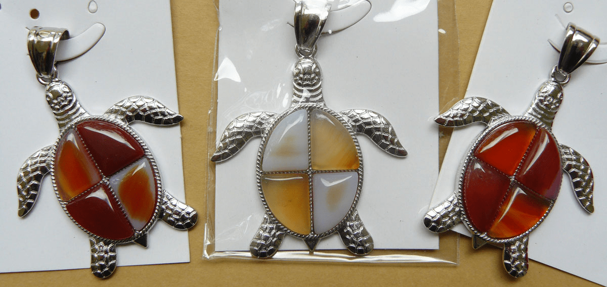 Turtle Carnelian pendant set in silver setting 21x26mm stone