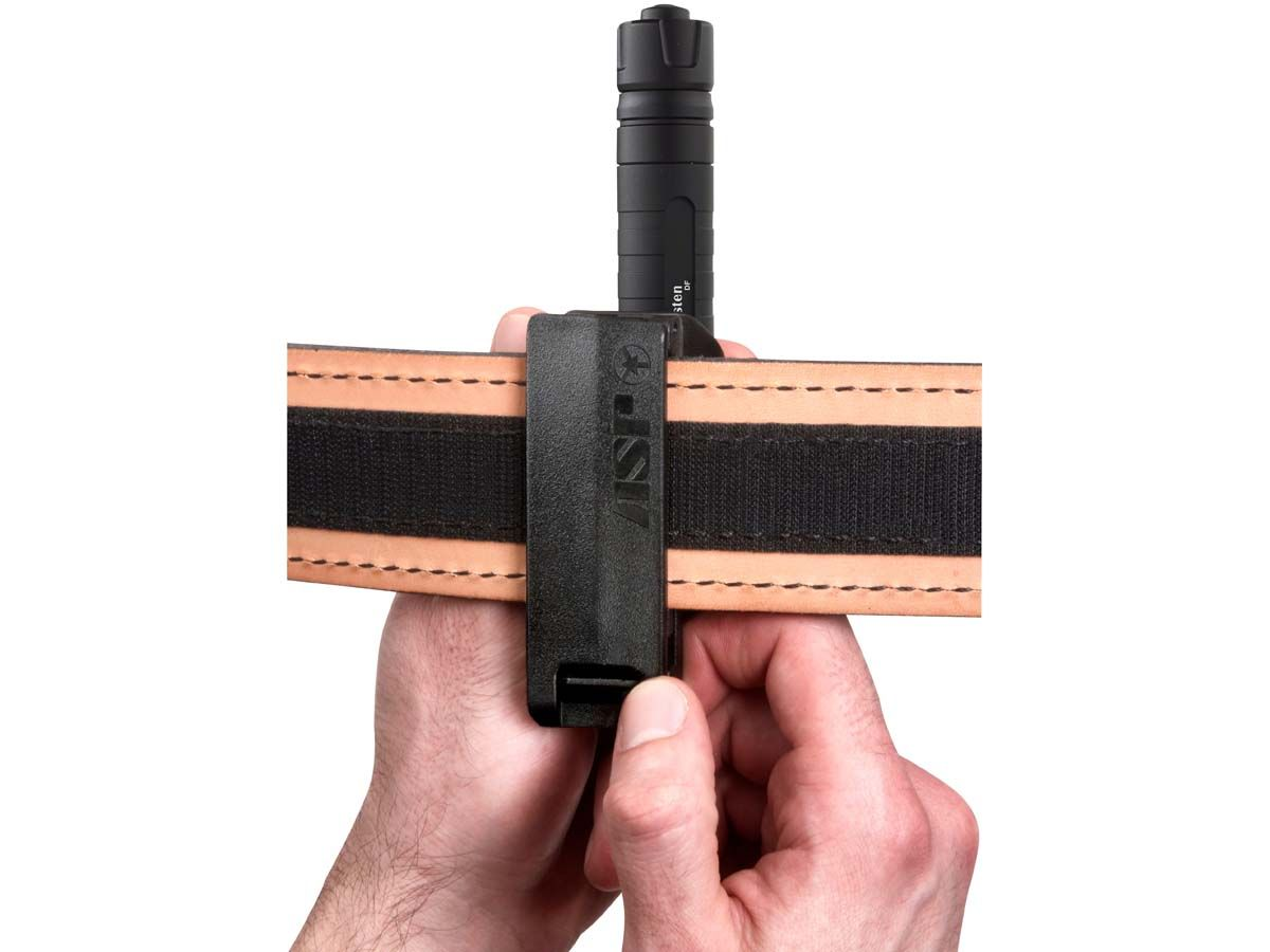 asp tactical holster with flashlight on a belt shown without belt being on a model holding freely