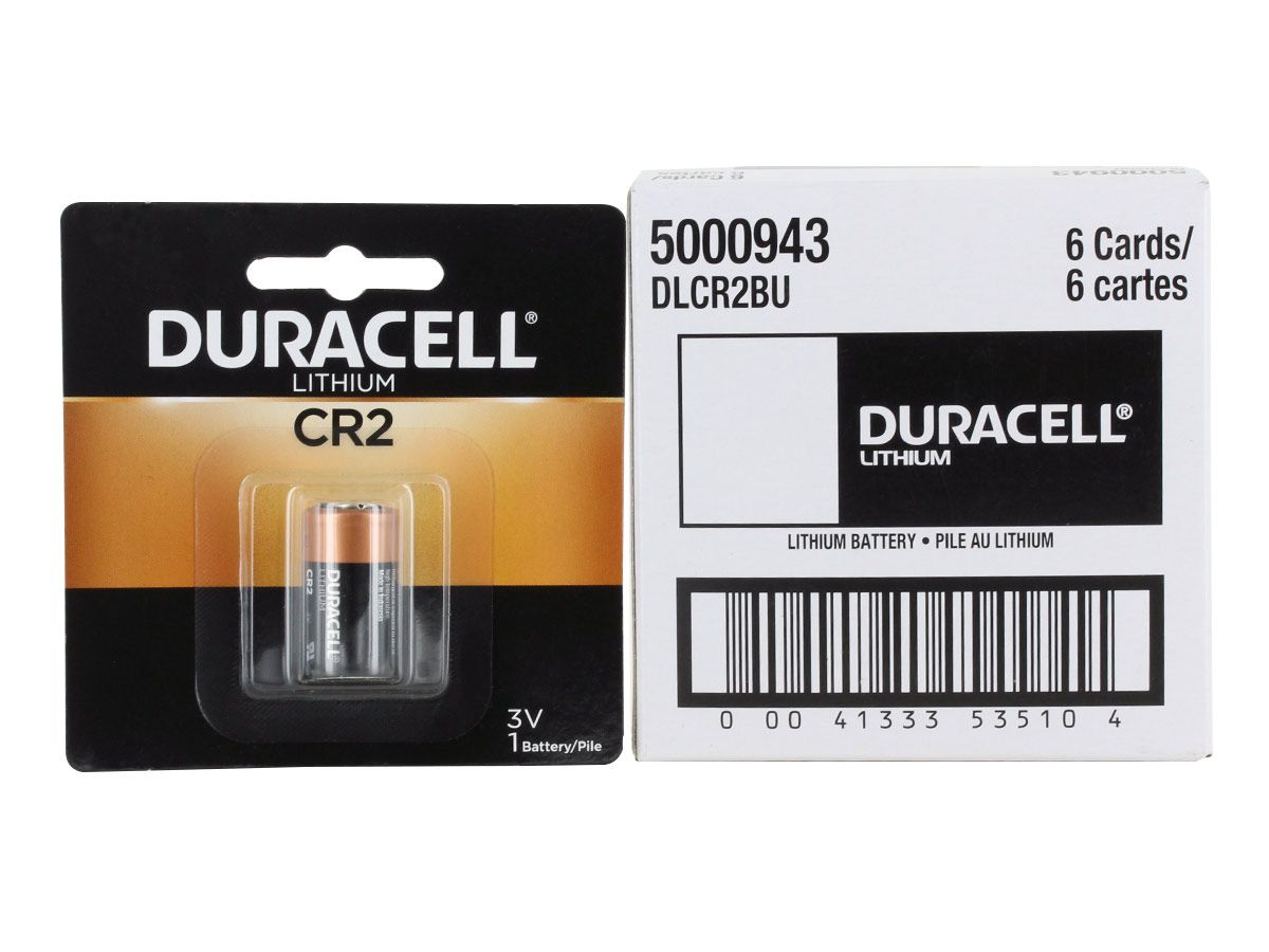 Duracell CR2 battery in retail card next to bulk box of 6