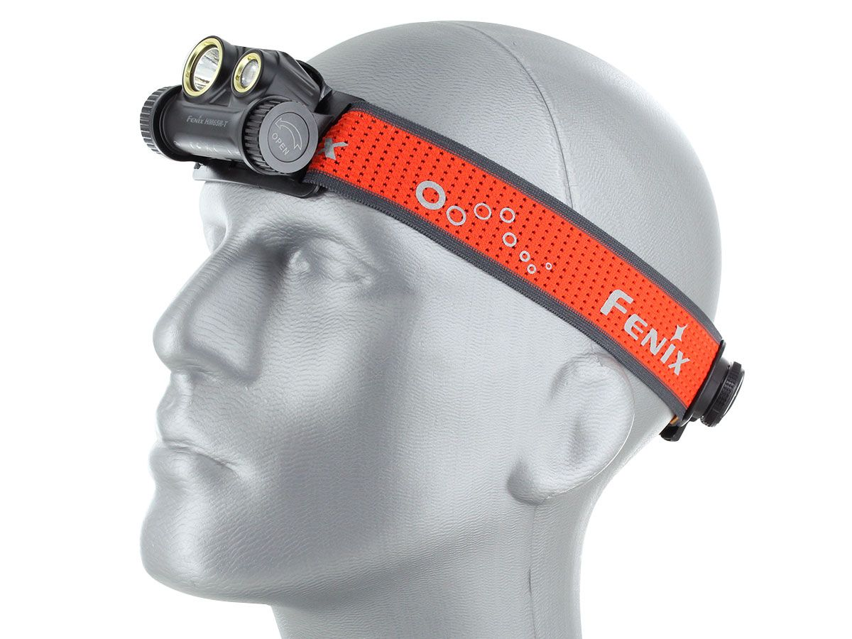hm65r-t headlamp being worn by mannequin head, facing left with lamp against head