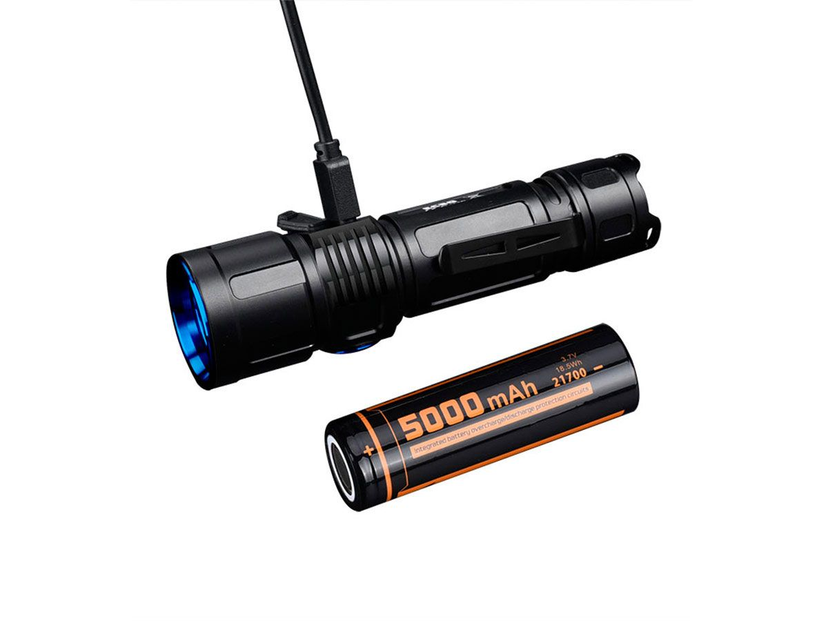 fitorch ec30 flashlight charging and included battery next to it