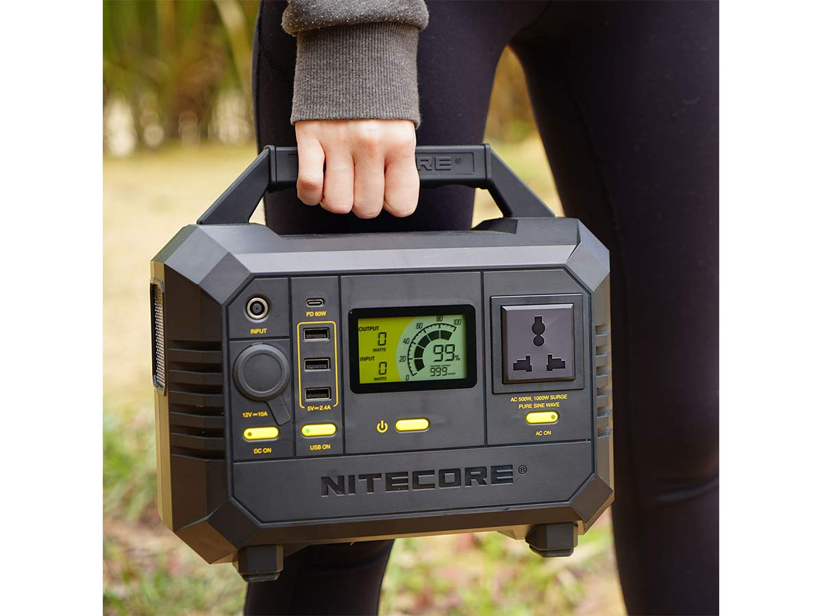 nitecore nes500 power station being carried by a camper