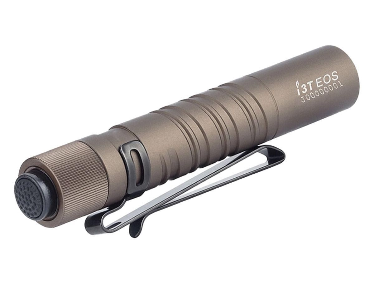 olight i3t tan angled up and to the right showing tailcap