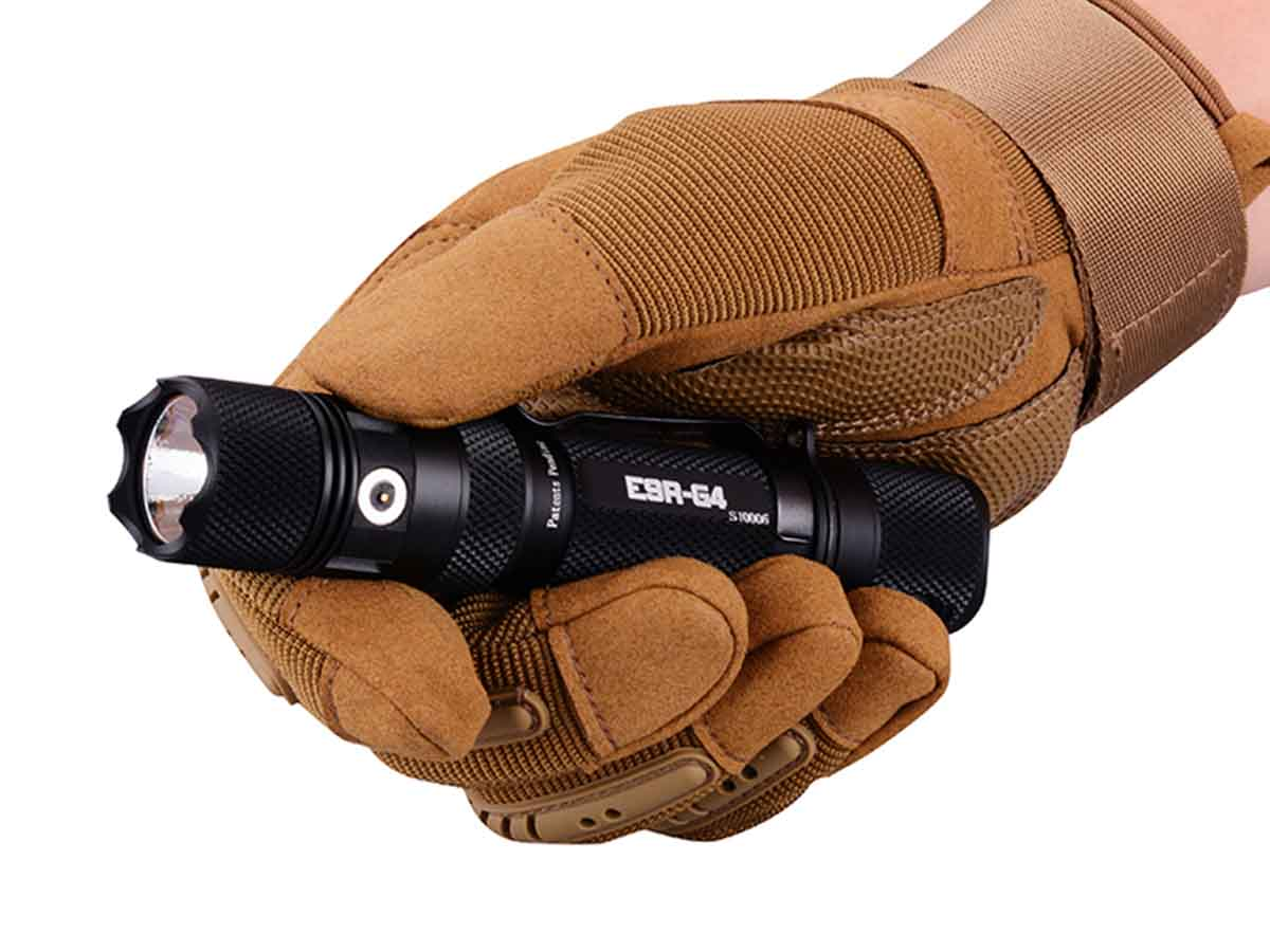 E9R-G4 clenched in hand gloved