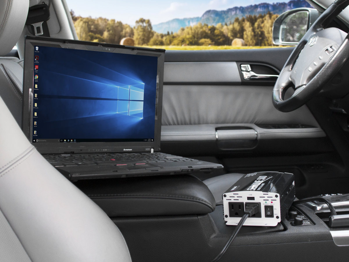wagan slimline 500w inverter being used in a vehicle to power a laptop