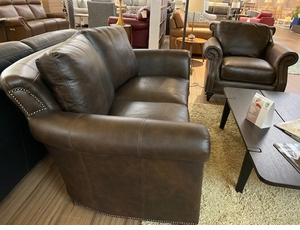 Curved back leather loveseat