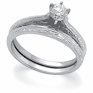 1/3ct. Diamond in a Platinum Cathedral Setting Engagement Ring